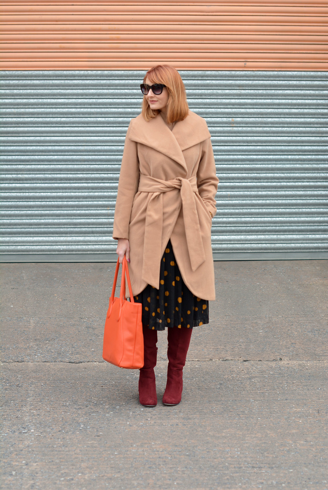 Camel wrap coat, vintage 70s polka dots dress, burgundy boots, orange tote | Not Dressed As Lamb