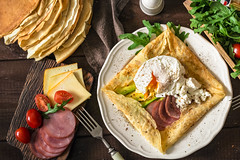 Crepe galette with meat, avocado and poached egg