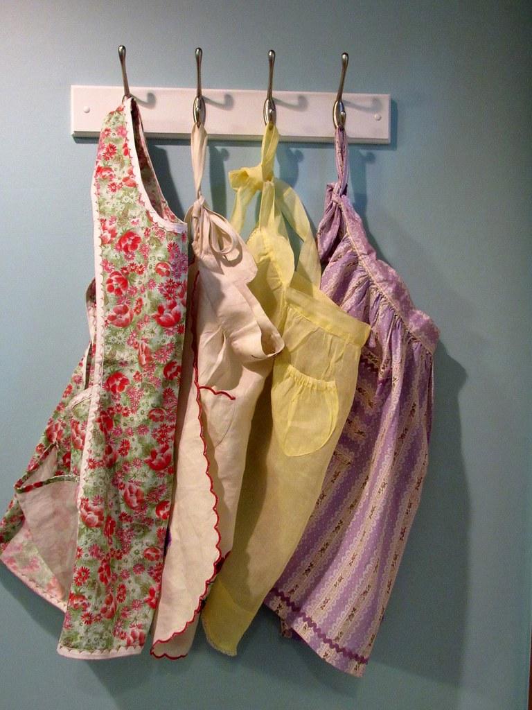 Four vintage aprons