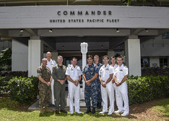Rear Adm. Patrick Piercey, U.S. Pacific Fleet's director of maritime operations and Commodore Mark Hammond, Royal Australian Navy director of general maritime operations pose for a picture with participants of the Operations Steering Group. (U.S. Navy/MC2 Brian Wilbur)