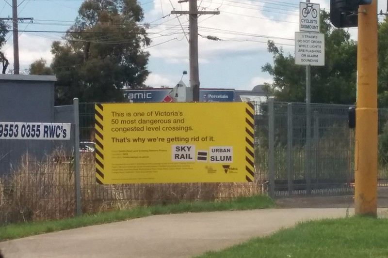 Anti Skyrail sign on a level crossing