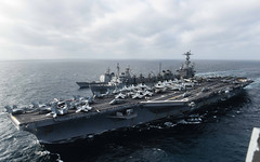 USS John C. Stennis (CVN 74) participates in a replenishment at sea with USNS Rainier (T-AOE 7) and USS Mobile Bay (CG 53) in the South China Sea on Friday. (U.S. Navy/MC2 Andrew P. Holmes)