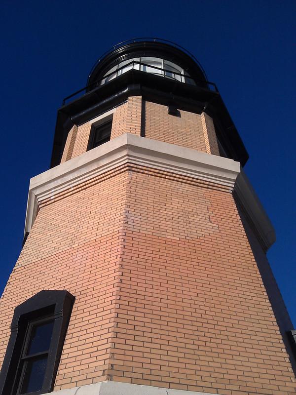 Dark blue sky behind the beacon viewed from below