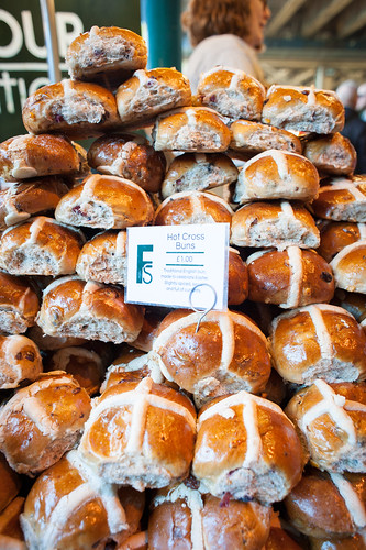 a huge pile of Hot Cross Buns something to try when traveling London with Kids