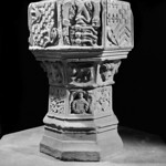 Sir William Stanley gave this font to St Chad's, the parish church of Holt, soon after he was made lord of Bromfield and Yale in 1484. The font was emblazoned with the various coats of arms of successive lords of Holt Castle. © Royal Commission on Ancient and Historical Monuments in Wales
