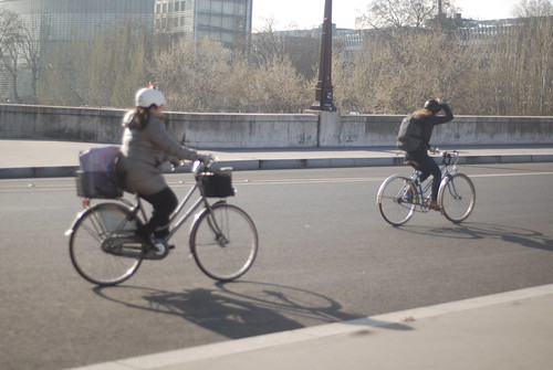 Parisians cycling to work