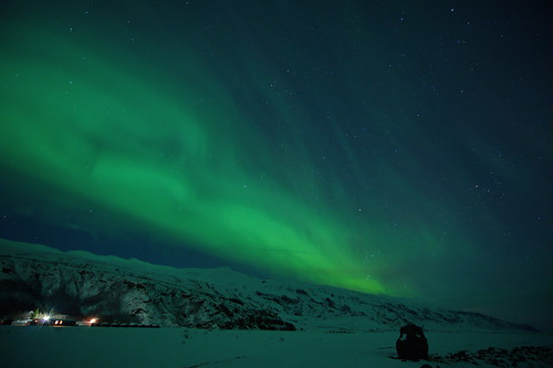 huts, snow and auroras