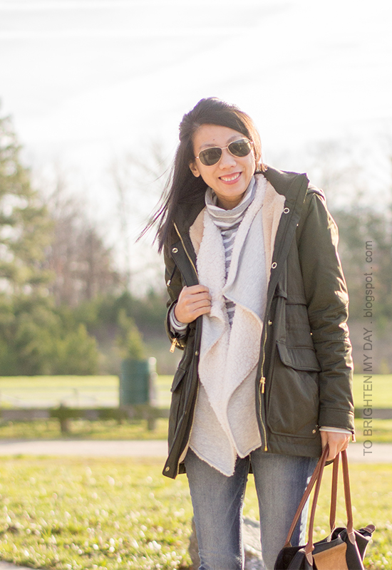 green parka, striped turtleneck, gray sherpa-lined open cardigan, jeans
