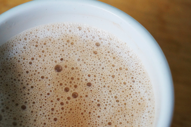 A close-up of froth in the mug: it looks terribly inviting, almost like a bubble bath