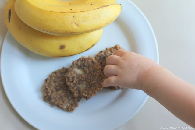Banana oatmeal cookies side with hand by little luxury list.