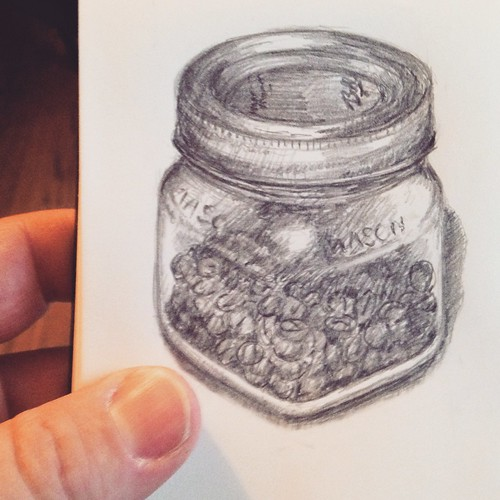 Mason jar of coffee beans.