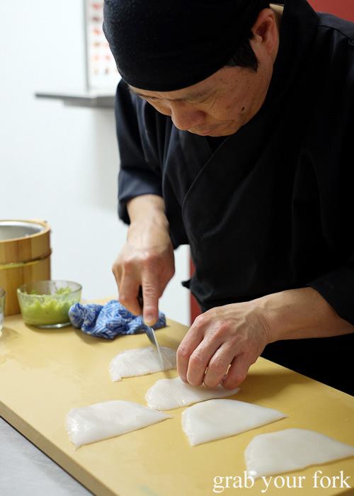 Chef Shinji Matsui making cuts into the ika raw squid at Sashimi Shinsengumi, Crows Nest