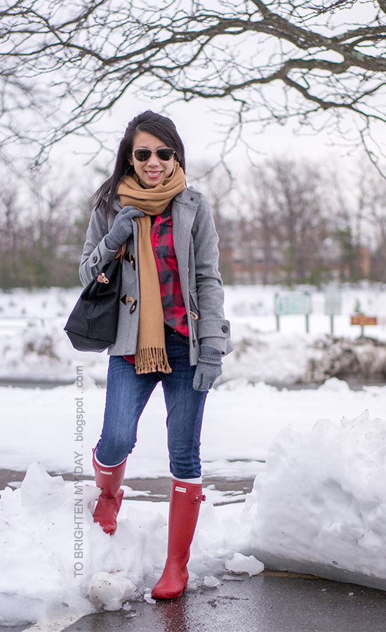 camel scarf, gray toggle coat, red buffalo check shirt, gray gloves, red rain boots