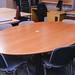 Oval cherry veneer boardroom table