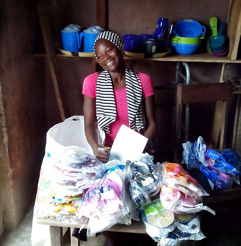 Mary is housebound and has been receiving help from the Sisters of St Louis and funding from St Genevieve's High School in Belfast. She is pictured here after moving into a rented apartment with a shop. She now sells plastic wares and other goods