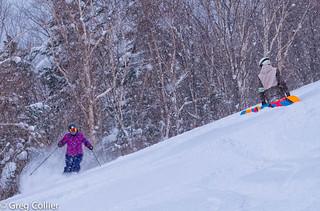 Cathy skiing past Tony.jpg