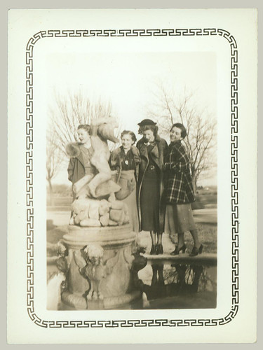 Four women and statue