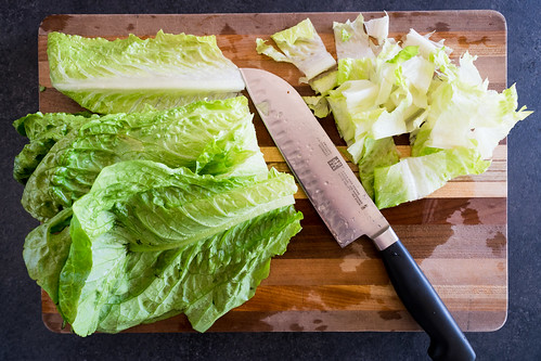 chopping the crisp romaine lettuce