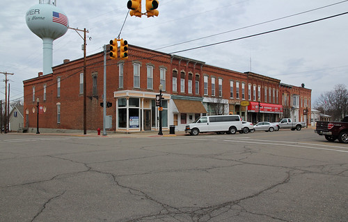 county street windows winter sky building brick tower cars water stone altered buildings lights traffic calhoun michigan structures utility 11 structure historic roofs sidewalk commercial wires homer poles storefronts twostory brackets awnings pent hoodmolds corbelled corbelling sills lintels