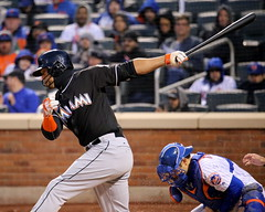 Giancarlo Stanton swings at a pitch
