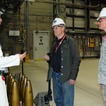 A Pueblo Chemical Agent-Destruction Pilot Plant ordinance technician explains the different sizes of munitions stored at the U.S. Army Pueblo Chemical Depot to visiting Air Force Academy personnel touring the plant. The projectiles shown are ACWA Test Equipment used for training purposes.