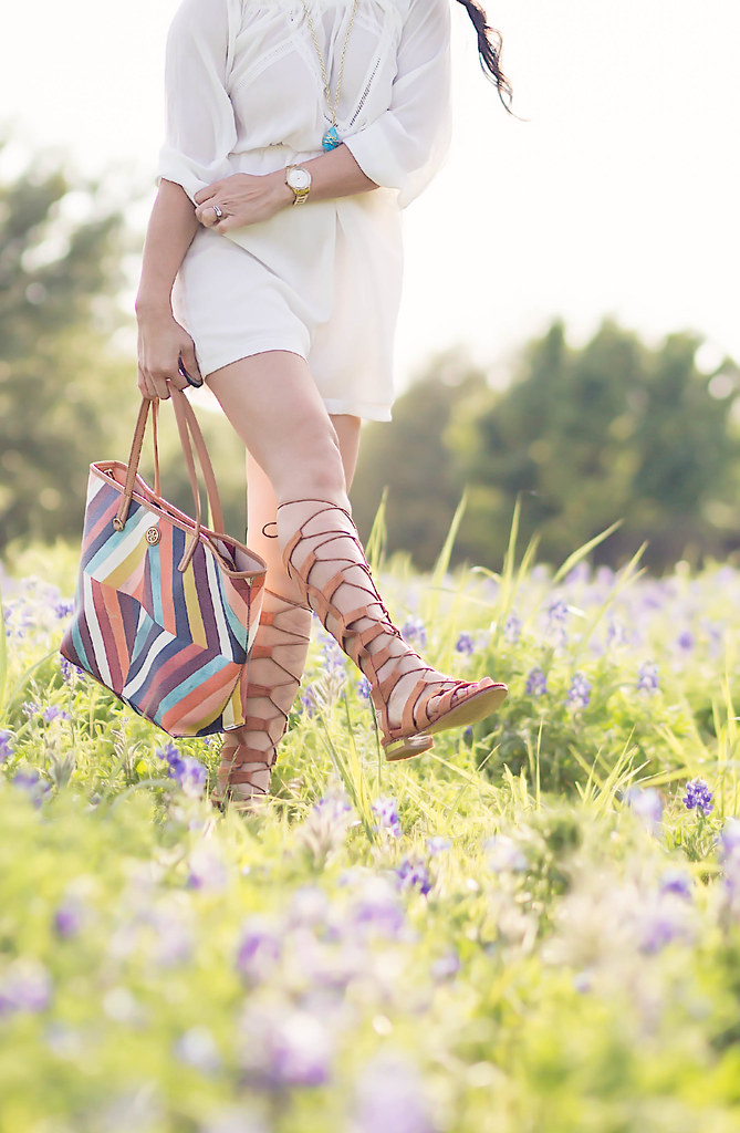 cute & little blog | white off-shoulder romper, lace-up gladiator sandals, tory burch kerrington bag, ray ban blue mirror aviators | texas bluebonnets | spring summer outfit