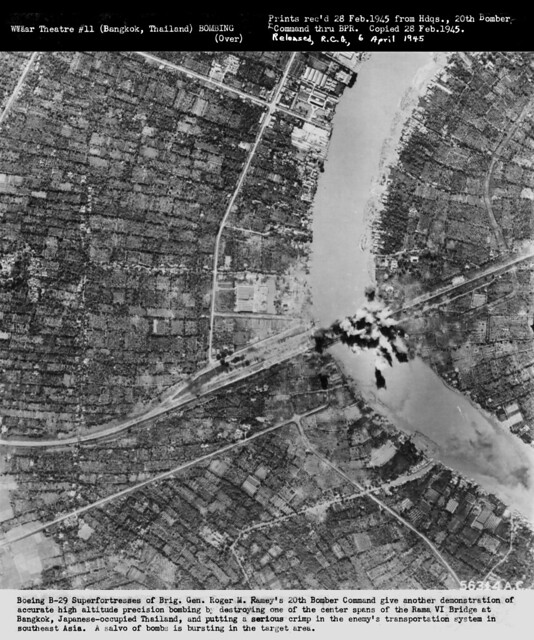 Boeing B-29 Superfortresses destroying one of the center spans of the Rama VI Bridge at Bangkok, Japanese-occupied Thailand