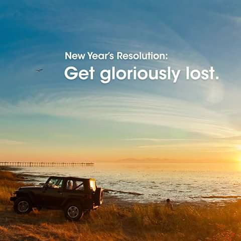A picture of a jeep on a beach with text in the sky reading:  New Year's Resolution: Get gloriously lost.