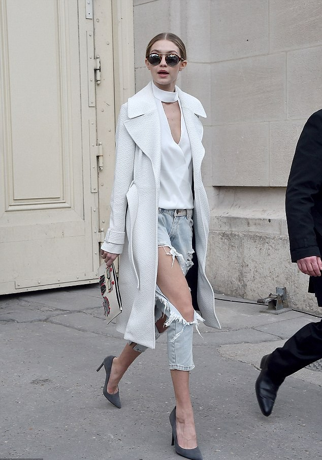 destroyed-torn-jeans-grey-heels-large-sunglasses-white-high-collar-wrap-blouse-long-white-coat