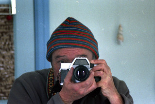 reflected self-portrait with Kiev-10 camera and stripey hat
