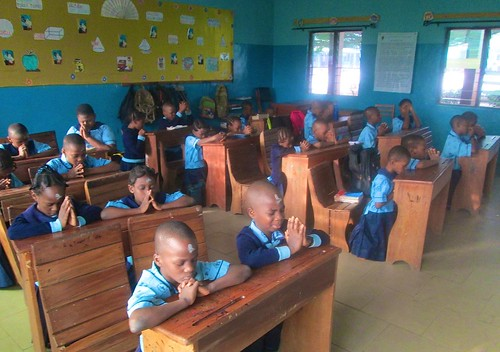 Students of St Louis Nursery and Primary School, Akure, praying after receiving ashes on Ash Wednesday