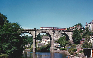A Pacer DMU on Knaresborough Viadict on a cloudless summers day during July 1989.