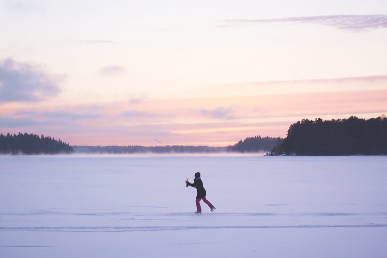 Iceskating under a pastel sky