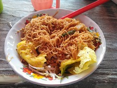 Nom baan chaao goi tea-oh this is a curious pancake made of tapioca flour filled with mung bean sprouts and minced pork served on top of more mung bean sprouts, cabbage and local herbs, a sweet and sour sauce and noodles. One of our favourite foods in Cam
