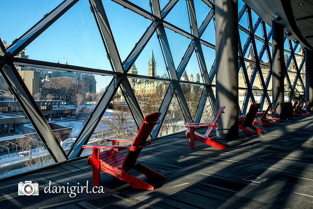 Red chairs overlooking downtown Ottawa