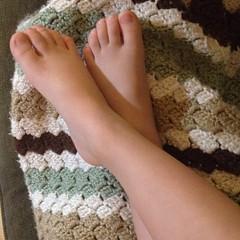 It's like a beach... When did her feet get so big? #tootsies #sobig