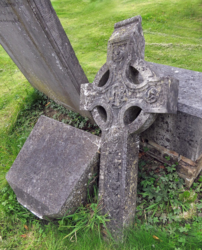 Tombstones and a Celtic Cross at Glasnevin, a historical Victorian Cemetery in Dublin, Ireland