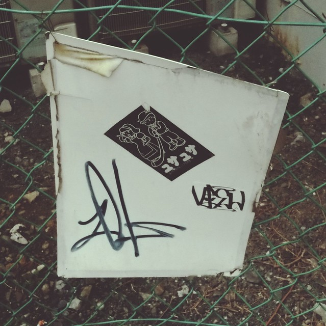 Whiteboard hanging on fence