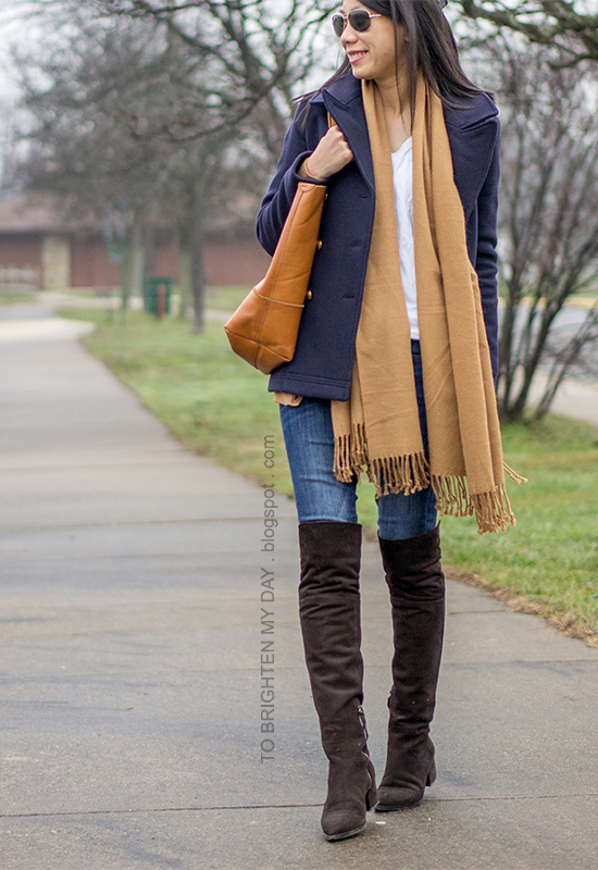 navy pea coat, camel scarf, camel varsity cardigan, white tee, jeans, brown suede over the knee boots