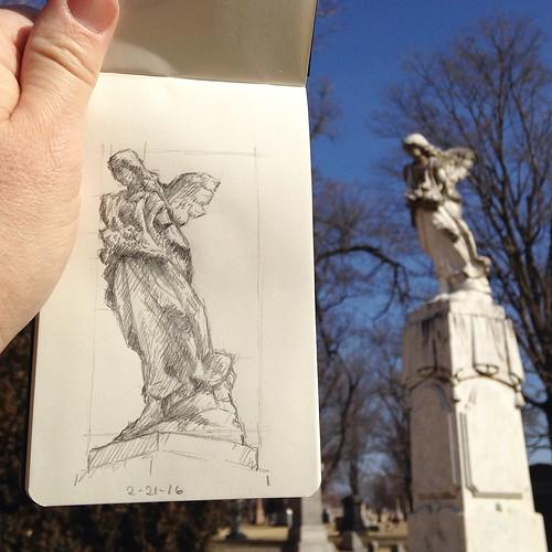 Sitting in the space between graves, sketching broken angels.