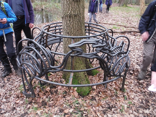 Deer chasing its tail in circular bench, Wormley Wood