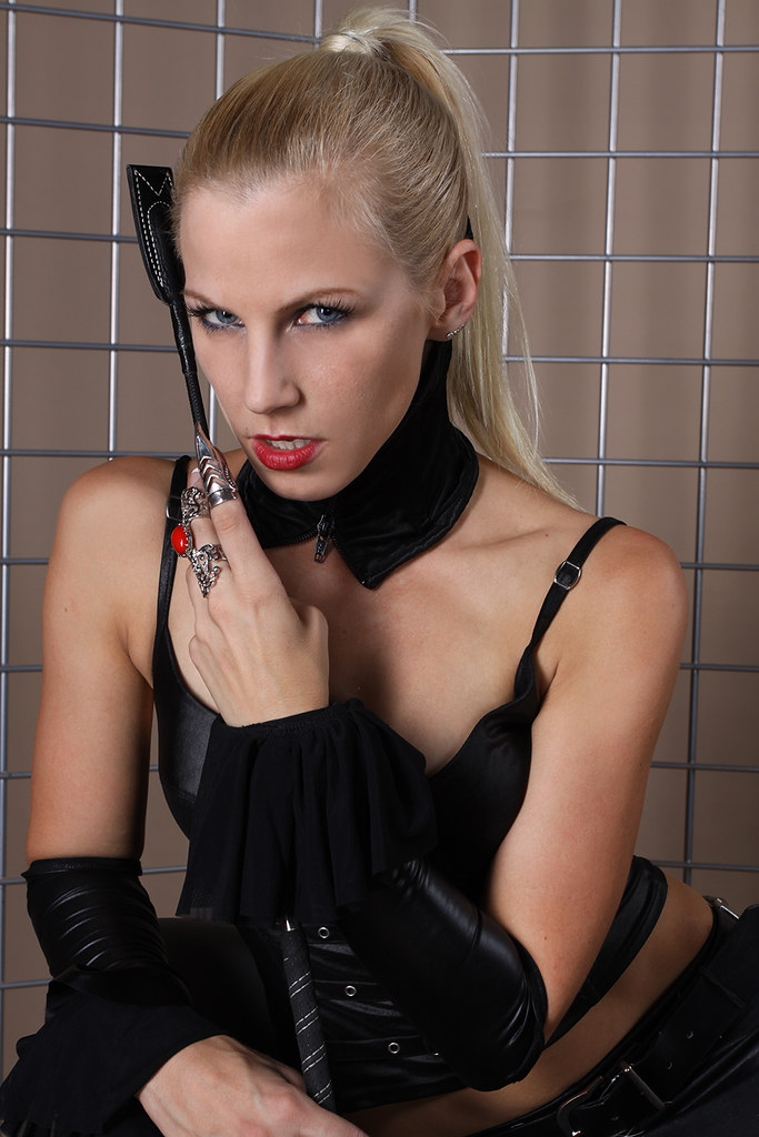 Blonde in leather with whip