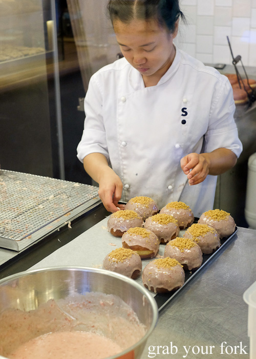 Glazing the strawberries and cream filled donut at Shortstop Coffee & Donuts, Melbourne