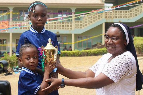 Sr Josephine Tiav presents the golden trophy to the overall winners at the Louisville Nursery and Primary School, Ibadan, Sports Day