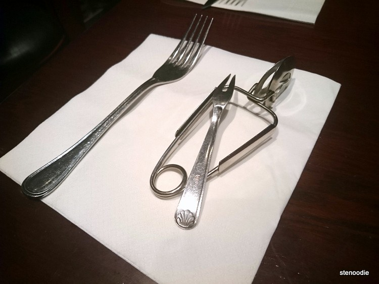 Fork and tools to use for eating escargots