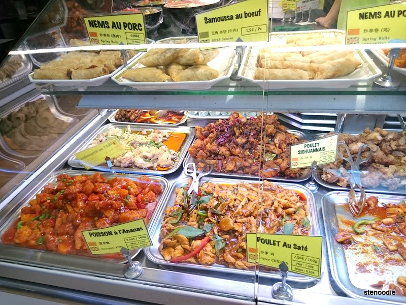 Assortment of Chinese food behind glass