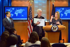 With USAID Administrator Gayle Smith and Spokesperson John Kirby looking on, Deputy Secretary for Management and Resources Heather Higginbottom presents the President's FY 2017 Budget Request for the U.S. Department of State and USAID during the Daily Press Briefing at the U.S. Department of State in Washington, D.C., on February 9, 2015. [State Department photo/ Public Domain]