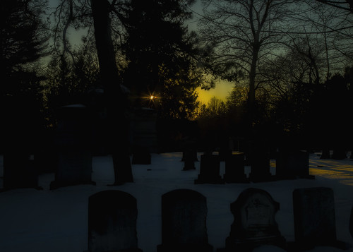 winter sunset sun cold cemetery headstone maine sunstar hss