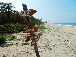 Sign in a caribbean beach
