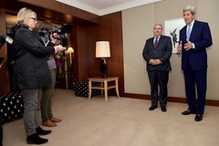 U.S. Secretary of State John Kerry, flanked by Jordanian Foreign Minister Nasser Judeh, addresses reporters at the President Wilson Hotel in Geneva, Switzerland, after arriving on May 1, 2016, for a series of meetings focused on the cessation of hostilities in Syria. [State Department photo/ Public Domain]